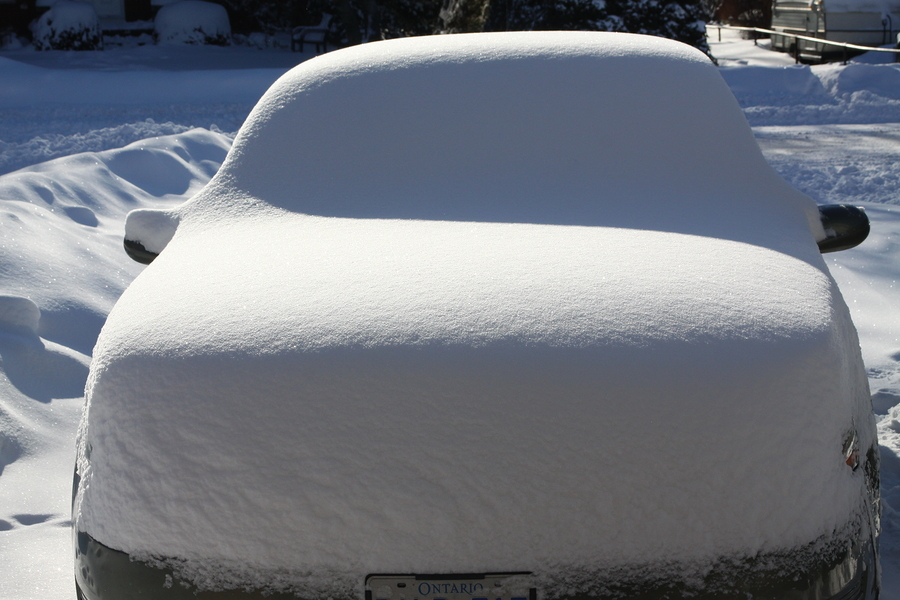 snow covered car and driveway in Mt Airy MD