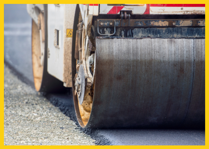 laying asphalt pavement with a paver
