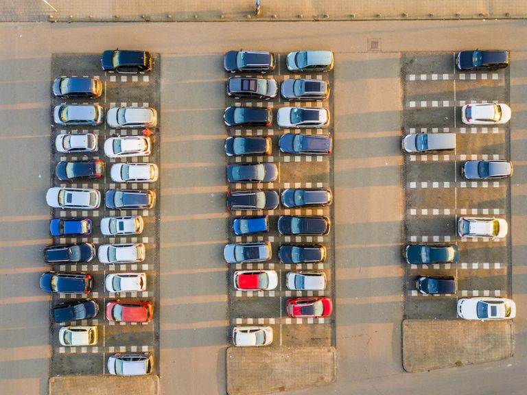 cars parked in a big parking lot