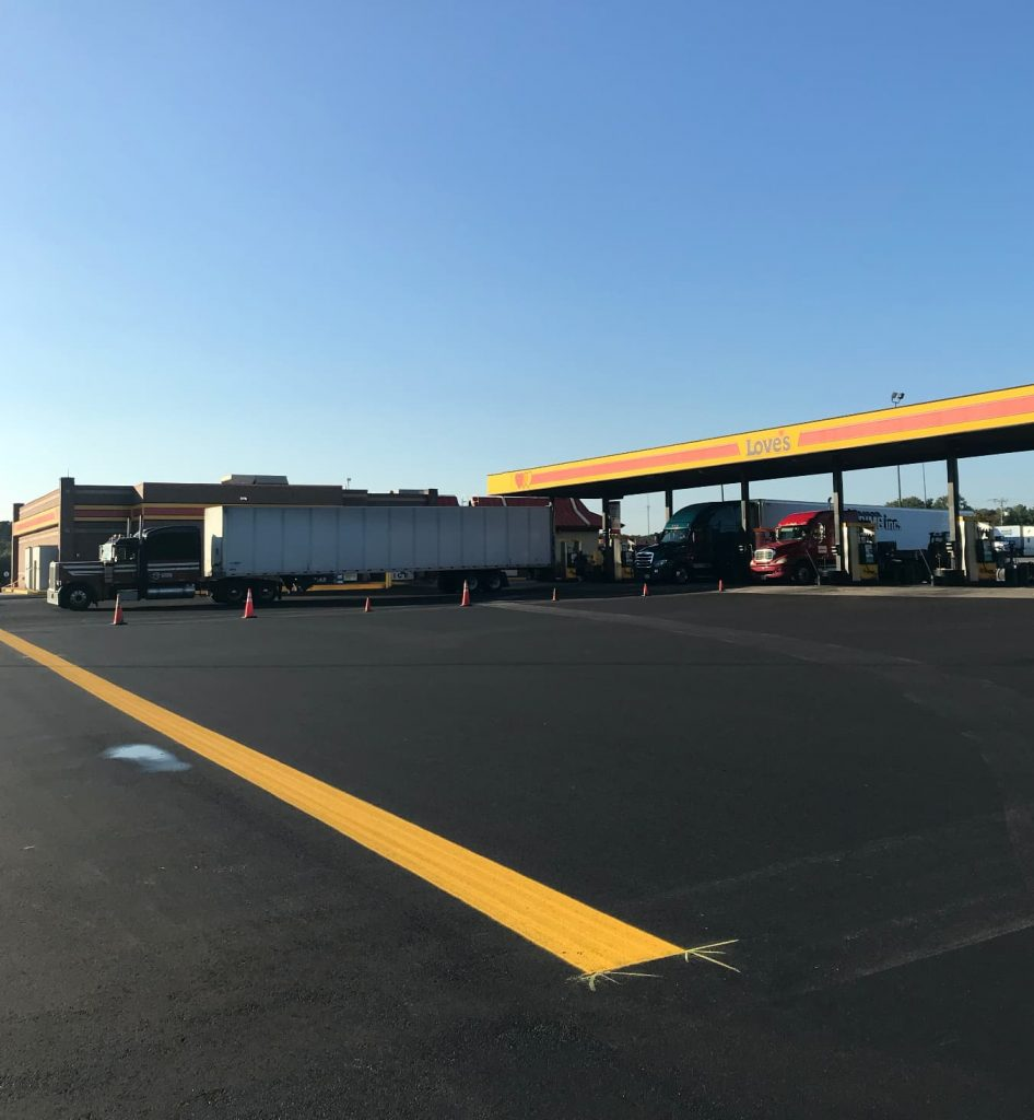 yellow lines painted by limitless paving and concrete for a gas station