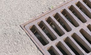 drain grill on a concrete surface is a factor in effective water drainage